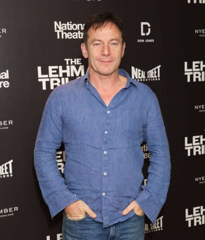 "Jason Isaacs poses at a press night for ""The Lehman Trilogy""."