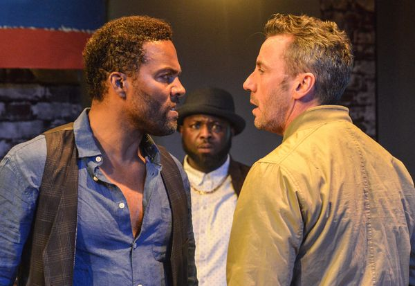 """Ray Fearon and costar Jay Simpson argue in a still from """"The Firm""""."""