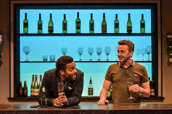 """Ray Fearon and costar Jay Simpson share a drink in """"The Firm""""."""