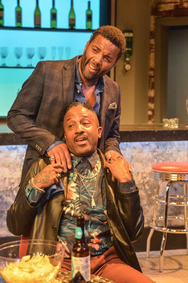 """Ray Fearon jokes with costar Clarence Smith in a still from """"The Firm""""."""