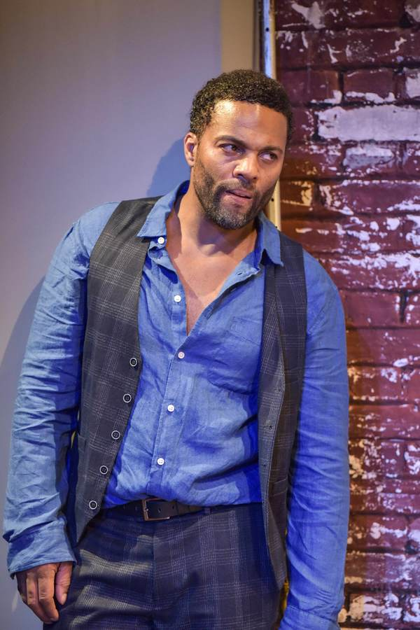 """Ray Fearon looks menacing in a still from """"The Firm""""."""