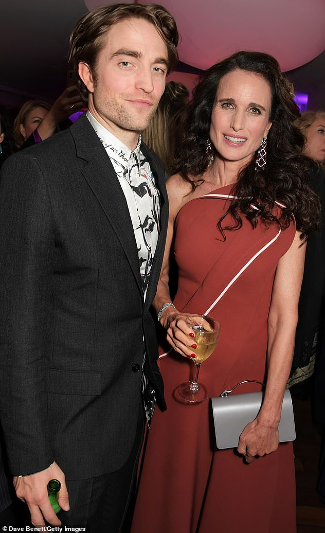 Robert Pattinson poses alongside Andie MacDowell at Cannes.