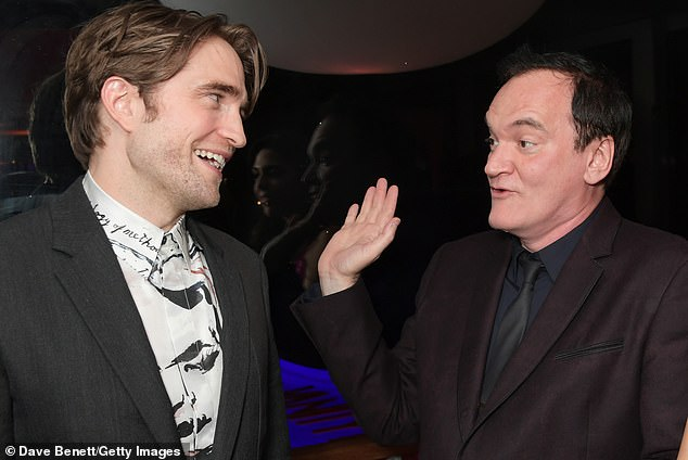 Robert Pattinson shares a laugh with Quentin Tarantino at Cannes.