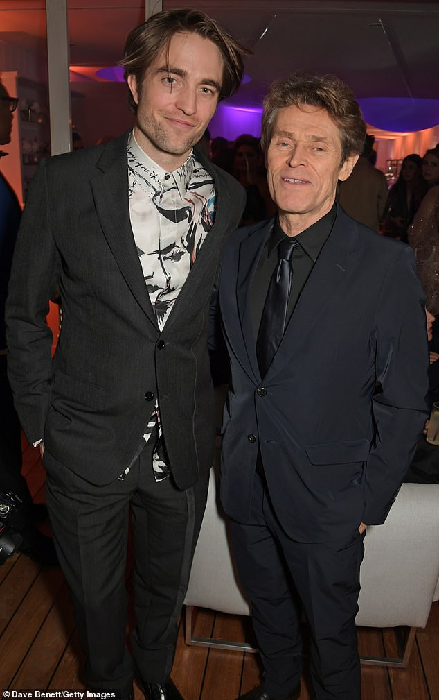 Robert Pattinson and Willem Dafoe pose for the camera at Cannes.