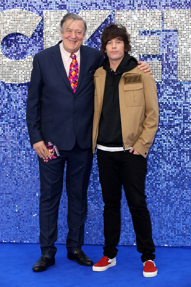 "Stephen Fry and husband Elliott Spencer pause for a snapshot at the UK premiere of ""Rocketman""."