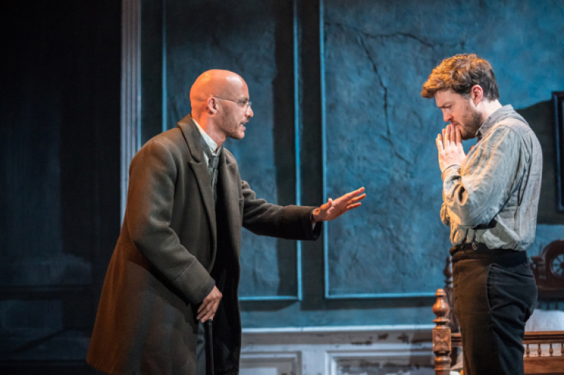 "Tom Burke and Jake Fairbrother share dialogue in ""Rosmersholm""."