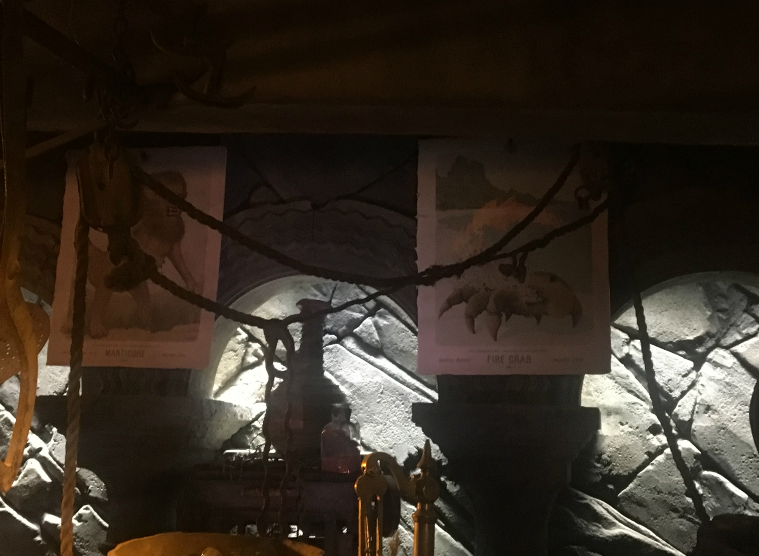 The Fire Crab and manticore illustrations are hung directly behind Hagrid's work table, where they are easily accessible for research purposes.