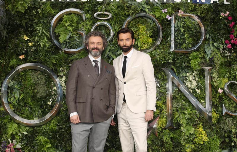 "David Tennant and Michael Sheen pose for a photo at the ""Good Omens"" premiere."