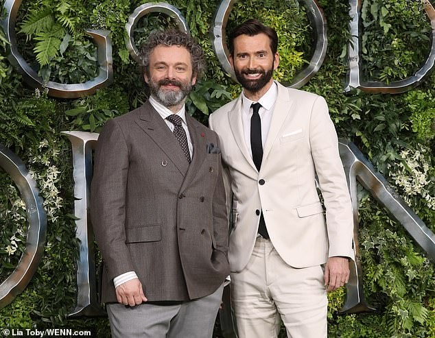 "David Tennant and Michael Sheen smile at the ""Good Omens"" premiere."
