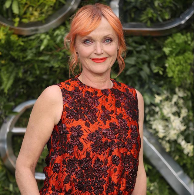 "Miranda Richardson smiles on the red carpet at the ""Good Omens"" premiere."