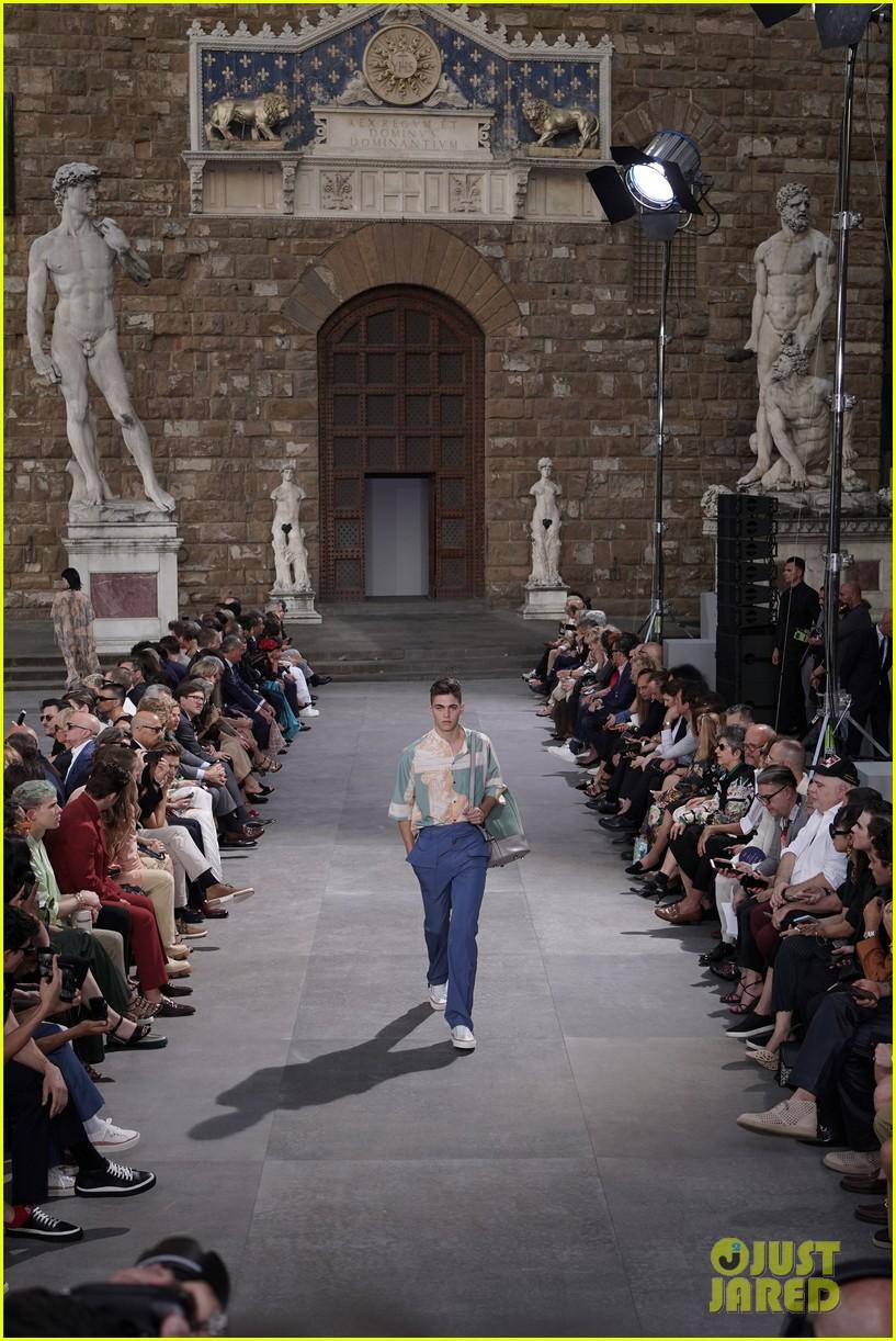 Hero Fiennes-Tiffin walks the runway at a Salvatore Ferragamo fashion show in Florence.