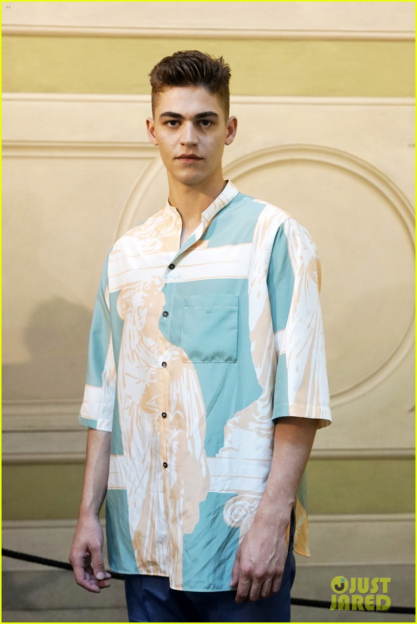 Hero Fiennes-Tiffin poses for a photo at a Salvatore Ferragamo fashion show in Florence.