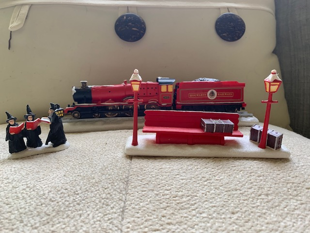 """HOGWARTS EXPRESS™"", Hogsmeade carolers, and train station bench, arranged"