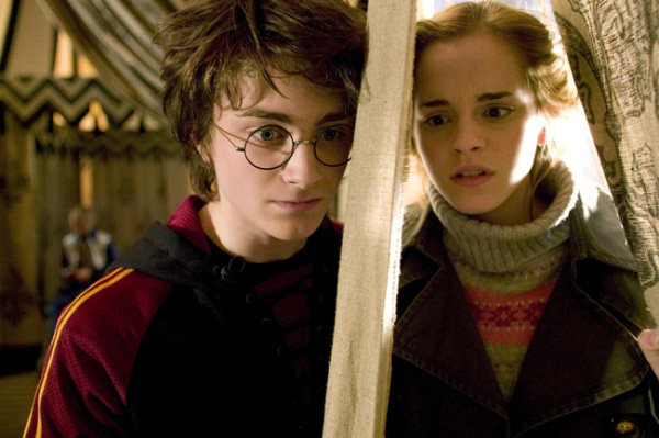 Harry and Hermione speaking through the tent to each other before the first Triwizard Tournament task