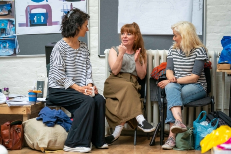 "Sophie Thompson and Suzie Toase chat with Indira Varma during rehearsals for ""Present Laughter""."