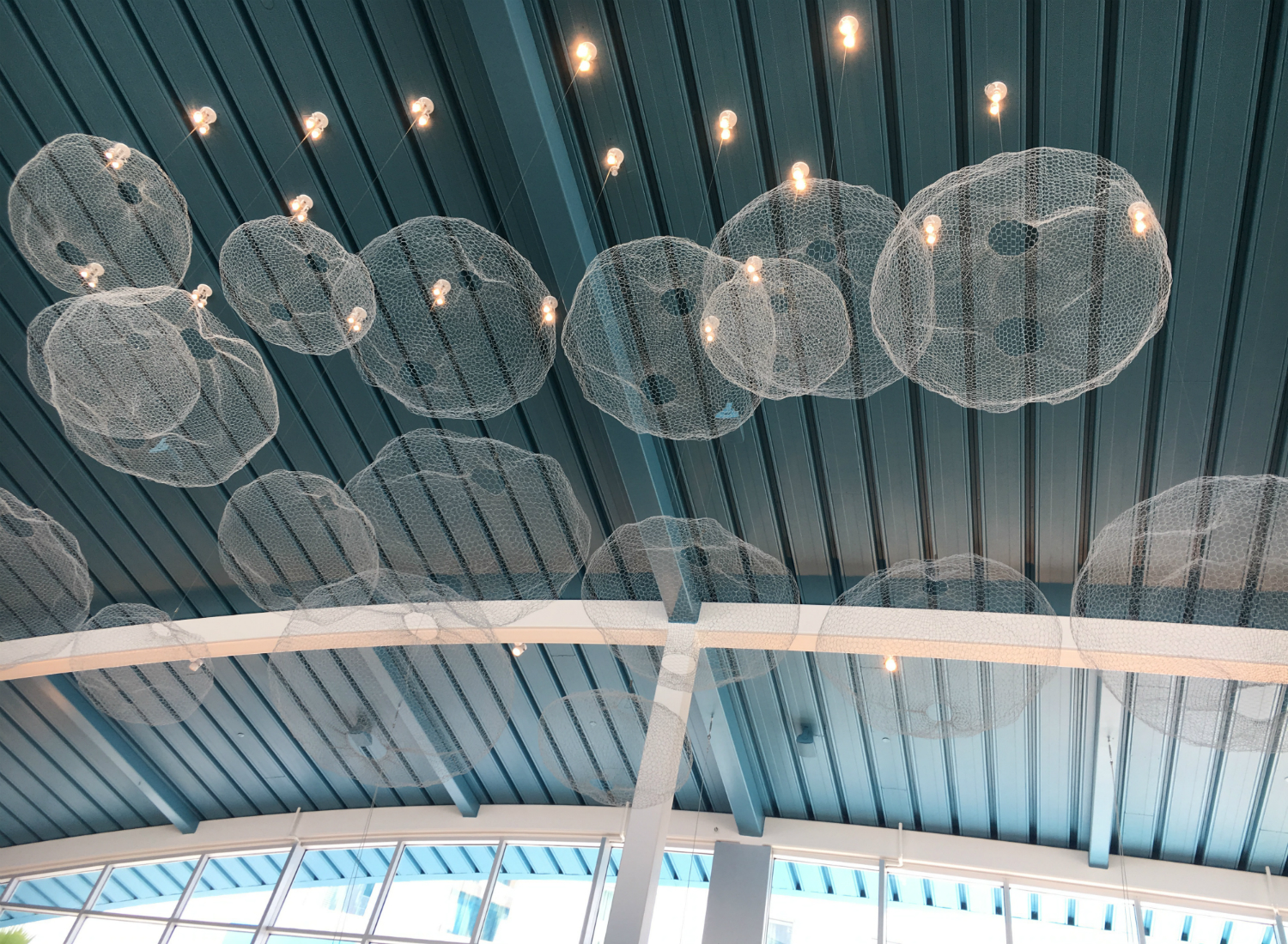 The lobby features decor on the ceiling reminiscent of sea foam.