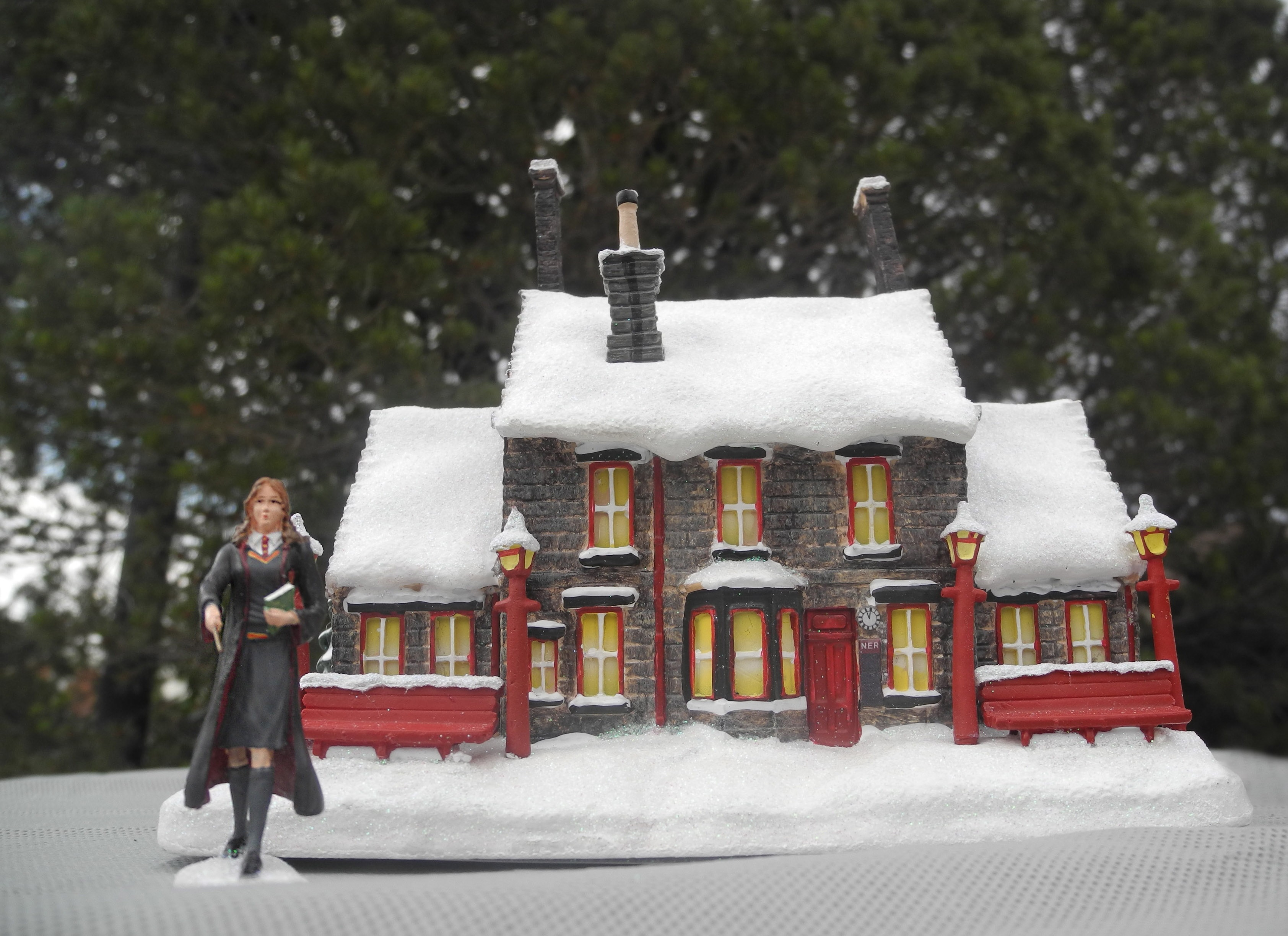 "The Bradford Exchange's ""HOGWARTS TRAIN STATION™"" with a free ""HERMIONE GRANGER™"" figurine transports you to a wintry day in Hogsmeade."