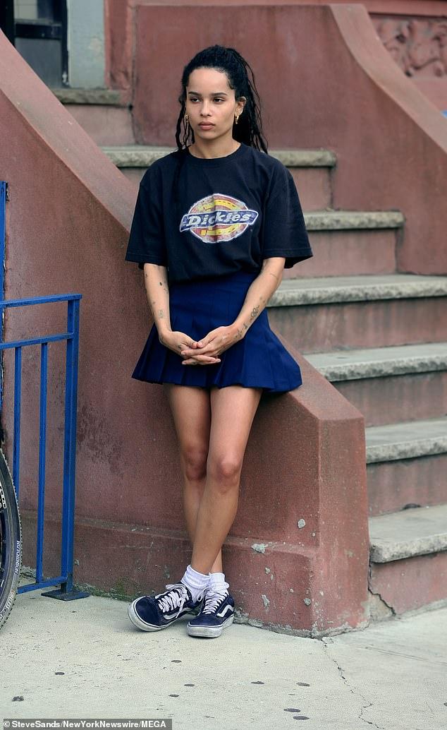 "Zoë Kravitz leans against a set of steps during filming for ""High Fidelity""."