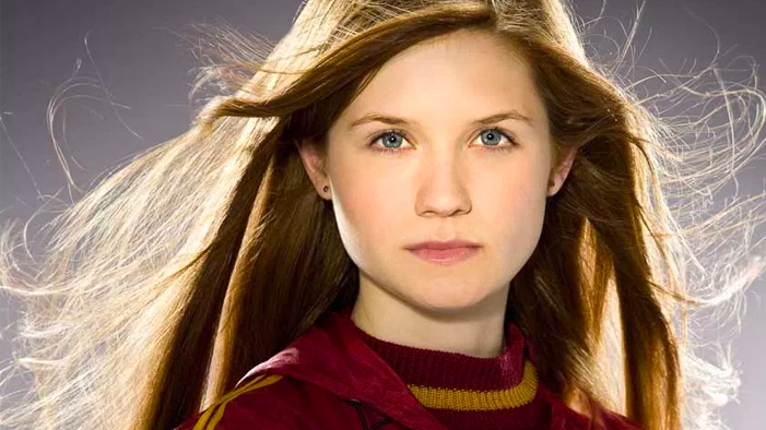 Ginny Weasley in quidditch robes, looking seriously toward the camera