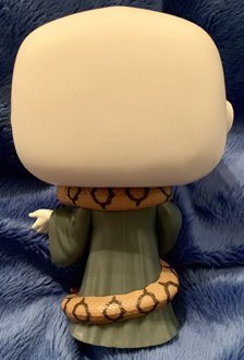 A close-up back view of the Voldemort Funko Pop! figure, Nagini wrapped around his neck