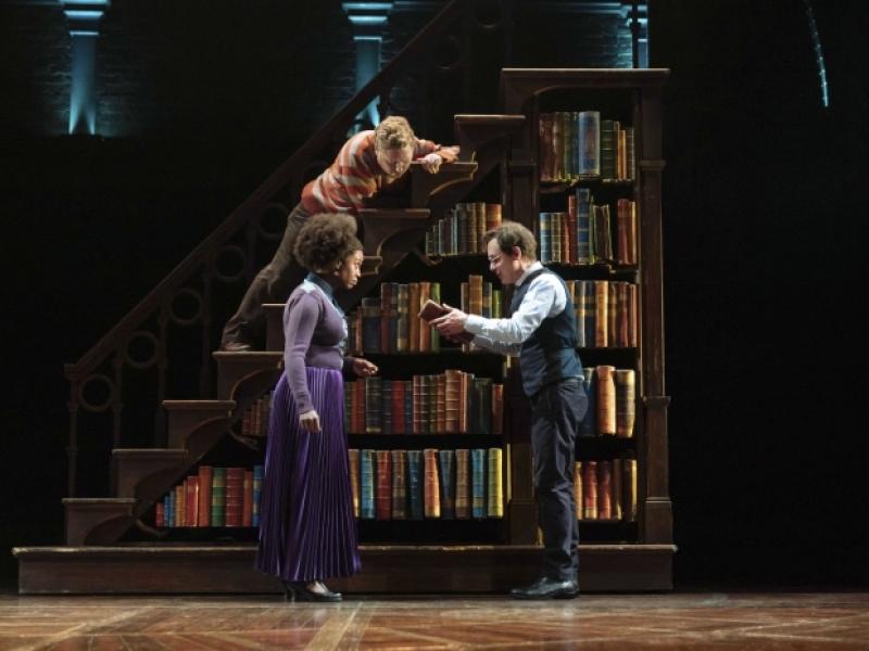 Michelle Gayle (Hermione Granger) and Thomas Aldridge (Ron Weasley) listen to Jamie Ballard (Harry Potter).
