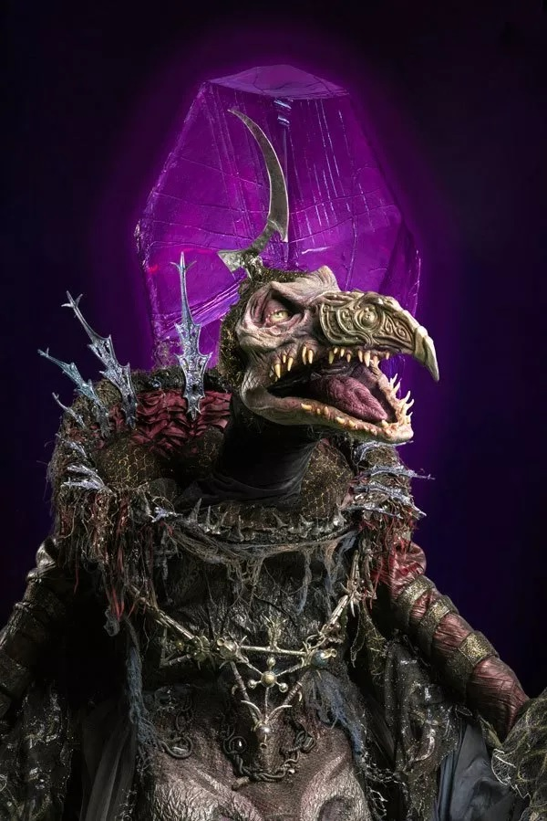 Pictured is Jason Isaacs' character, The Emperor, a Skeksis.
