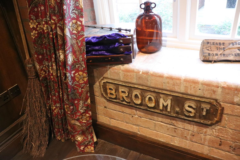 Enchantment Chamber Broom Street sign detail on brick windowsill