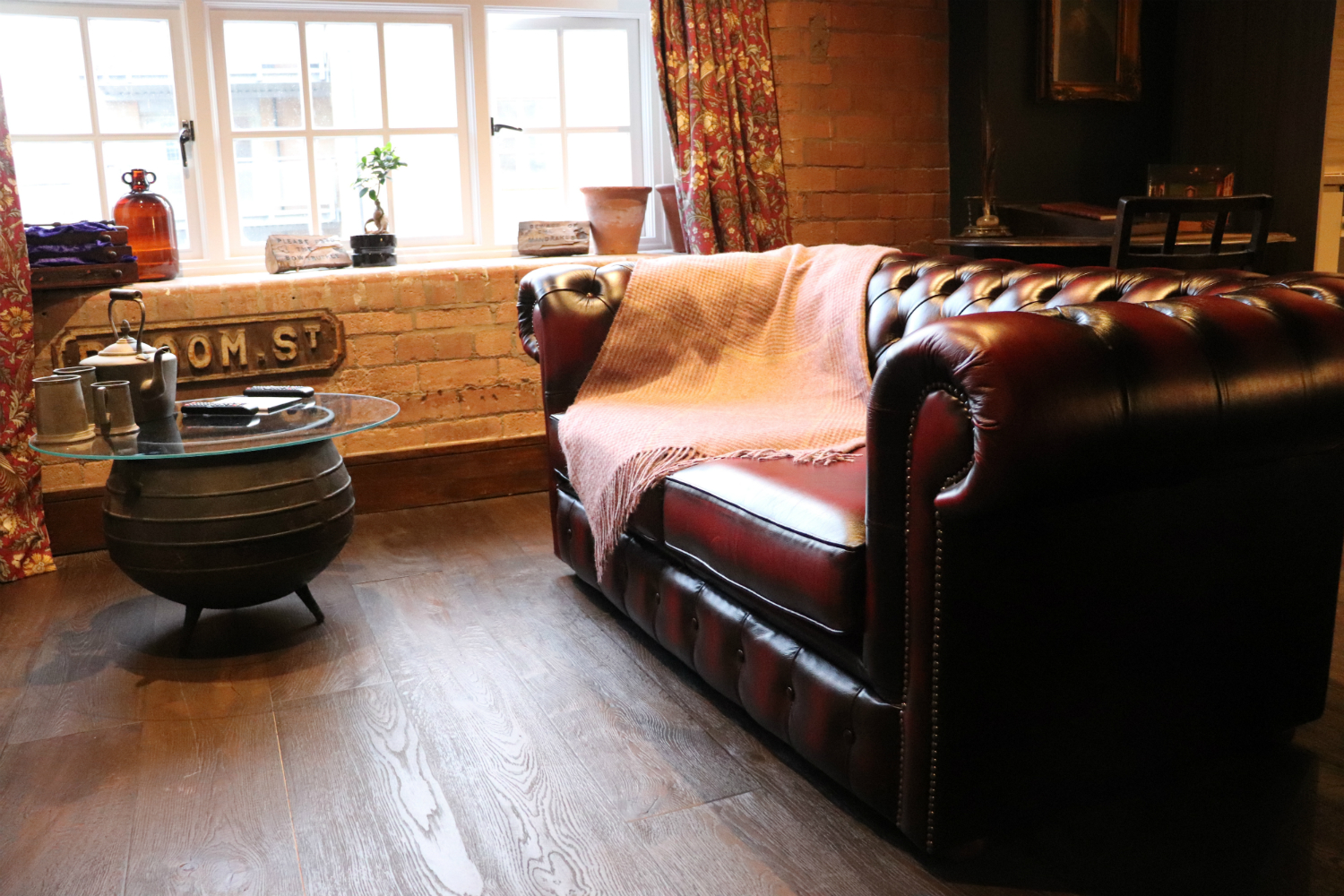 Enchantment Chamber leather couch and cauldron end table in living room