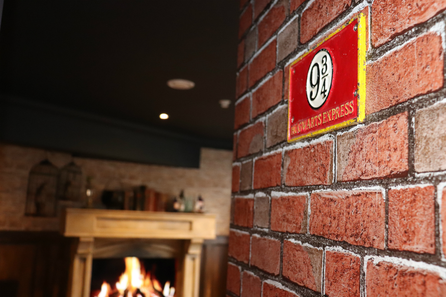 Enchantment Chamber brick accent wall detail with platform nine and three-quarters