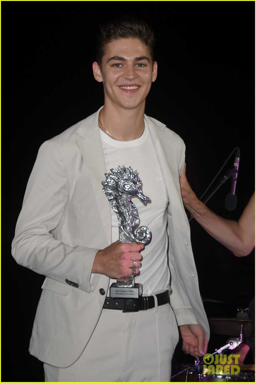 Hero Fiennes-Tiffin smiles as he displays his Breakout Actor of the Year award at Ischia.
