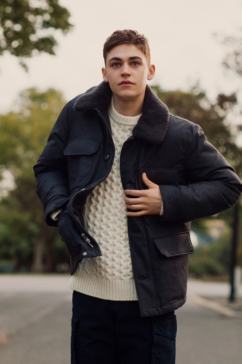Hero Fiennes-Tiffin checks his pockets in a photo from Woolrich's autumn lookbook.