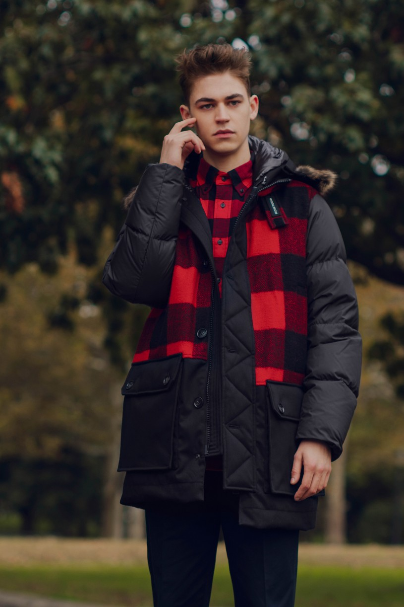 Hero Fiennes-Tiffin chats on his mobile in a photo from Woolrich's autumn lookbook.