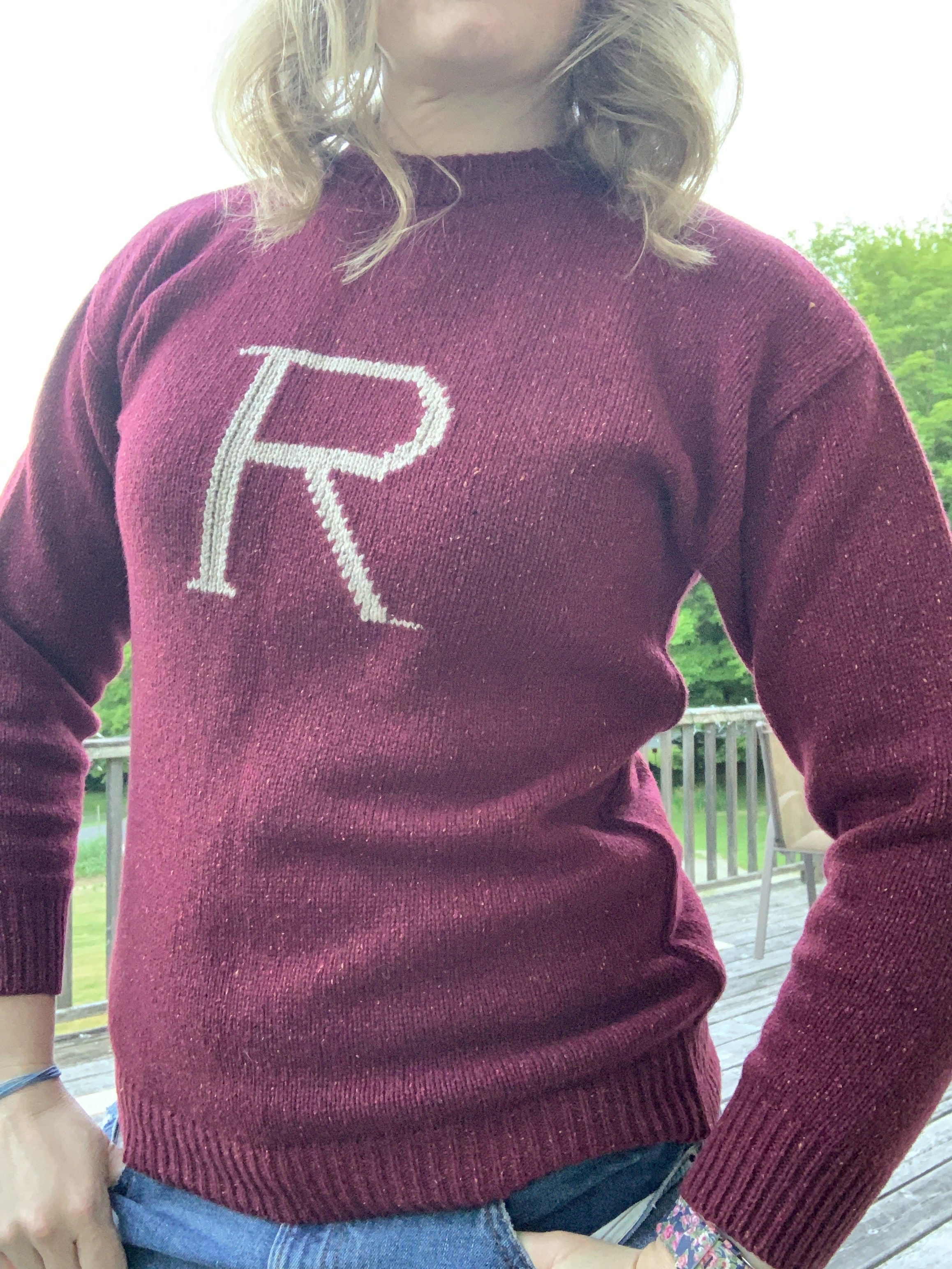 """Side view and close up on the """"R"""" in the middle of the sweater"""
