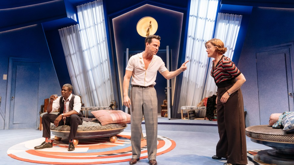 "Andrew Scott addresses Sophie Thompson as Abdul Salis listens in ""Present Laughter""."