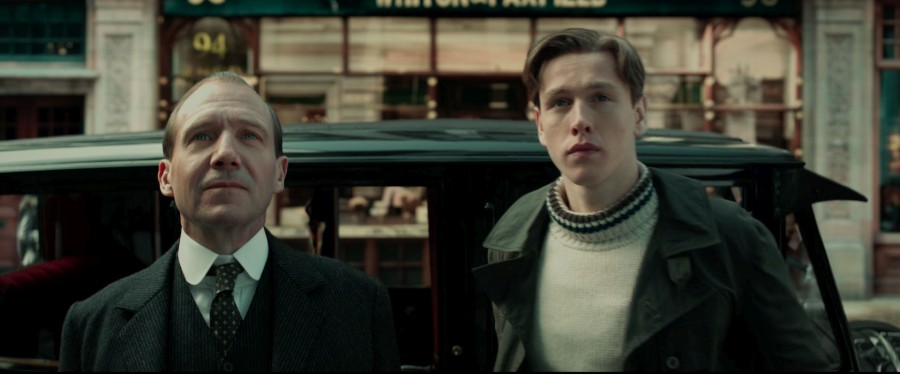 "Ralph Fiennes and his young protégé gaze at secret headquarters in a scene from ""The King's Man""."