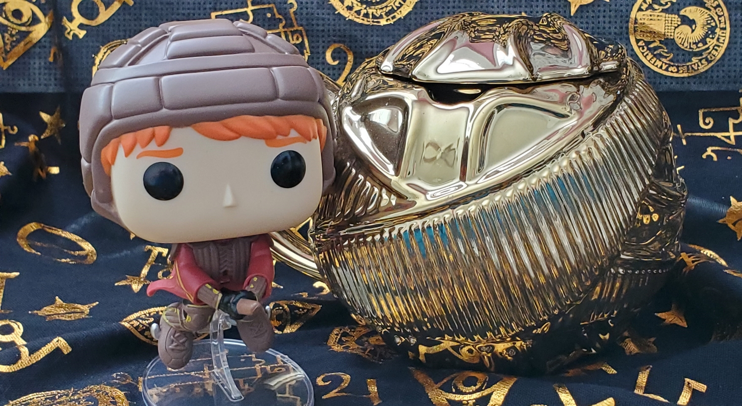 Ron Weasley Funko POP!, pictured with the Harry Potter Golden Snitch Coffee Mug from Hallmark Gold Crown