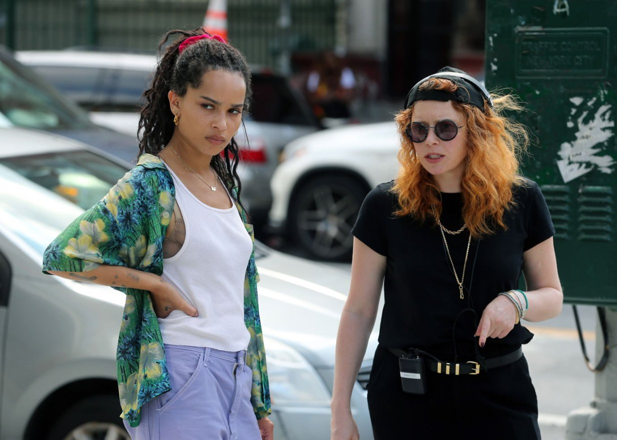 "Zoë Kravitz listens to director Natasha Lyonne during filming for ""High Fidelity""."