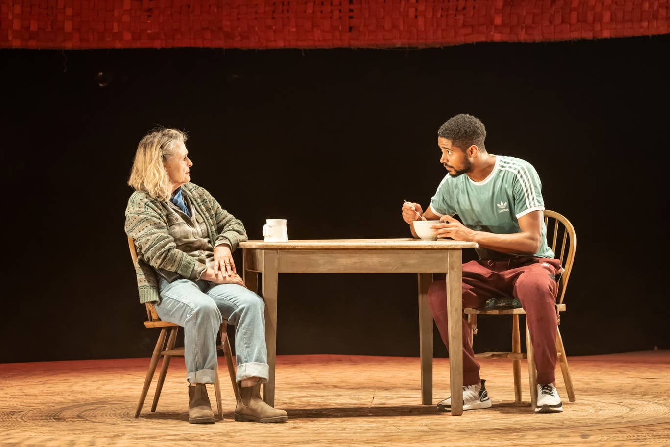 "Alfred Enoch speaks with his onstage grandmother in a still from ""Tree""."