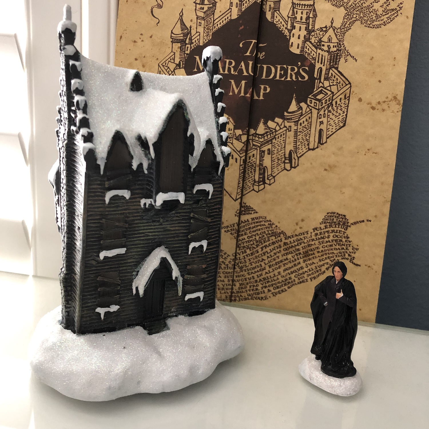 "The Bradford Exchange's ""PROFESSOR SEVERUS SNAPE™"" and ""THE SHRIEKING SHACK™"" on a shelf with the Marauder's Map"
