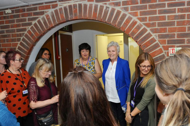 Dame Julie Walters chats with attendees of the opening of the new My Sister's House center.