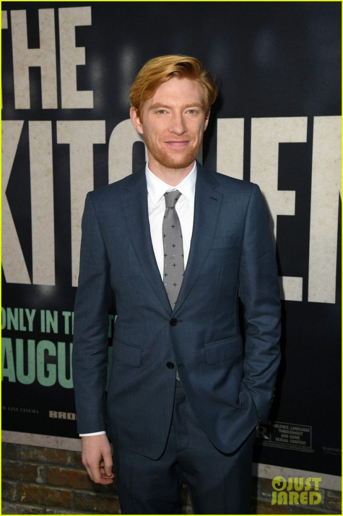 "Domhnall Gleeson poses at the Hollywood premiere of ""The Kitchen""."