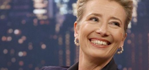 Emma Thompson is pictured smiling, probably at a red carpet.
