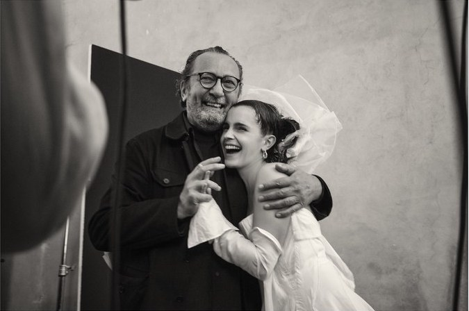 Emma Watson and photographer Paolo Roversi laughing behind the scenes at the Pirelli Calendar 2020 photoshoot.