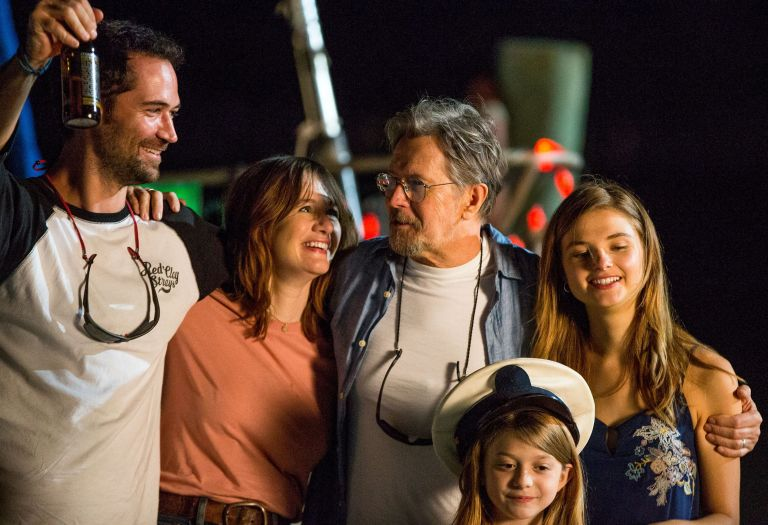 "Gary Oldman gathers his onscreen family in this film still from ""Mary""."