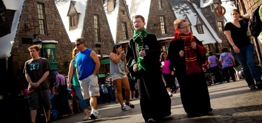 A pair of youngsters walk the streets of Hogsmeade, decked out in their House robes, at the Wizarding World of Harry Potter at Universal Orlando Resort.