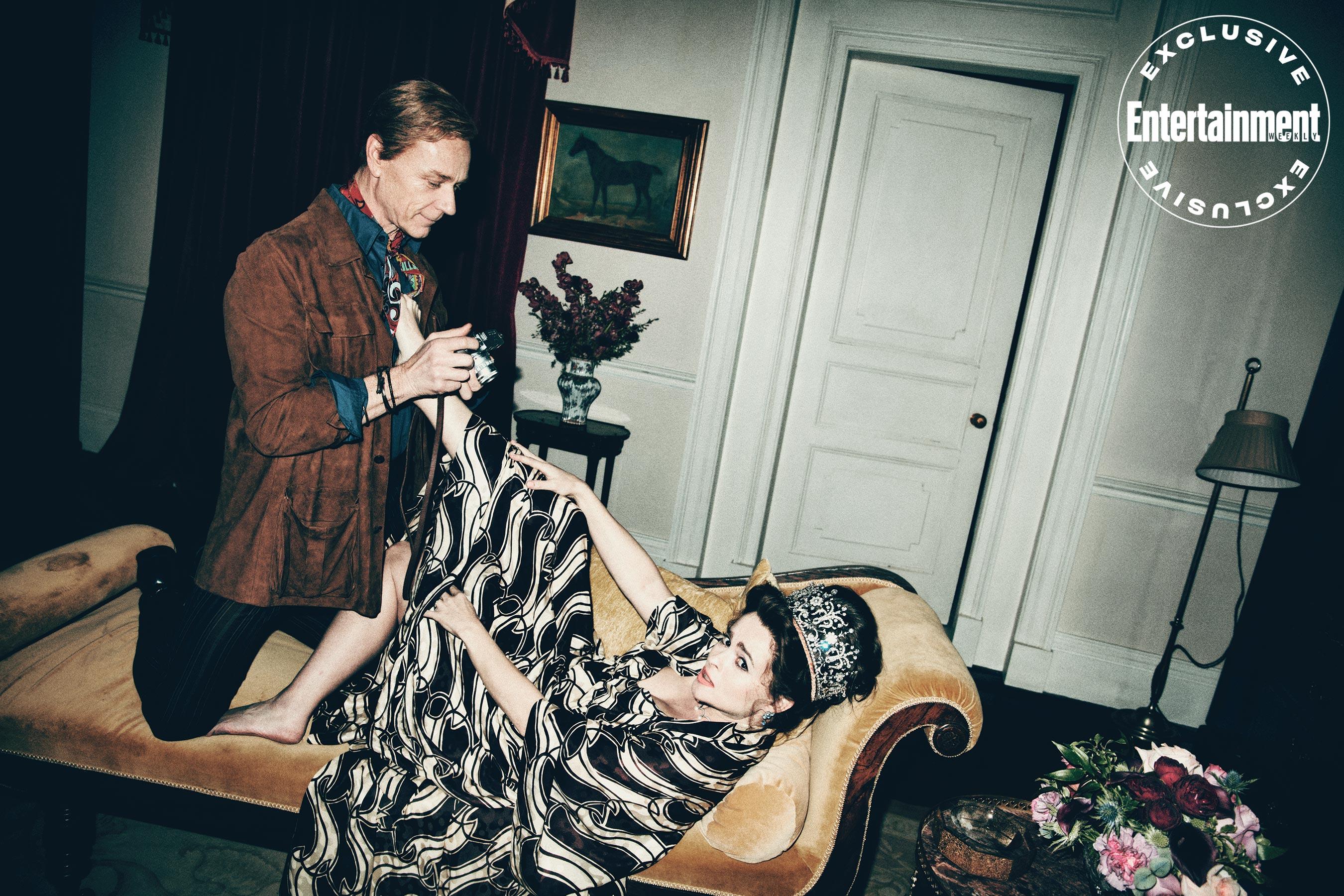 "Helena Bonham Carter kicks back at a photo shoot for ""The Crown"" with costar Ben Daniels."