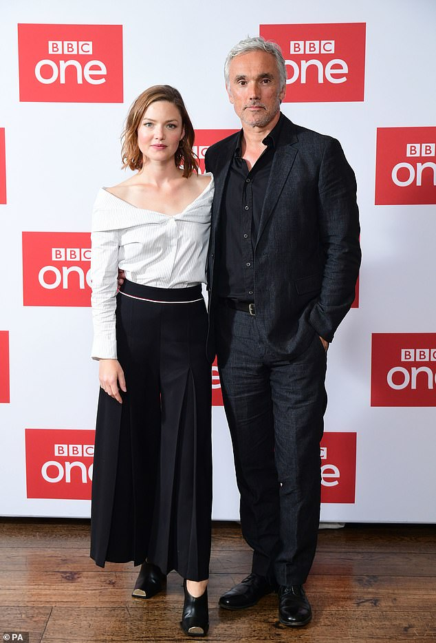 """Holliday Grainger poses with costar Ben Miles during a photo call for """"The Capture""""."""