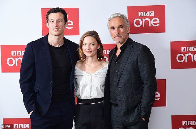 """Callum Turner, Holliday Grainger, and Ben Miles pose during a photo call for """"The Capture""""."""