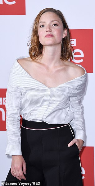 """Holliday Grainger poses for the camera during a photo call for """"The Capture""""."""