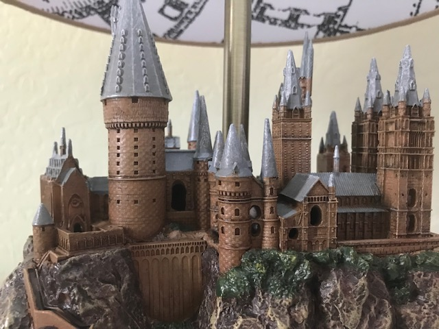 Harry Potter Hogwarts Lamp from The Bradford Exchange: close-up view of the left-hand side of the sculpture, including a tall tower, the clock tower courtyard, and the bridge.